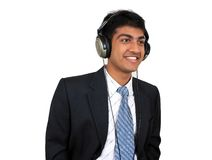 Listening to music. Young Indian business man listening to music (Series Royalty Free Stock Images