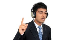 Listening to music. Young Indian business man listening to music (Series Stock Image