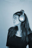 Listening to music-4 Royalty Free Stock Photos