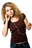 Listening To Music. A young woman listening to music on a portable mp3 player royalty free stock photos
