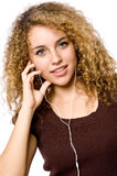 Listening To Music. A young woman listening to music on a portable mp3 player stock photo