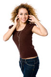 Listening To Music. A young woman listening to music on a portable mp3 player royalty free stock images