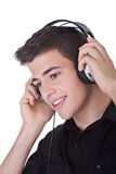 Listening to Music. Young man, enjoying music with headphones. Isolated on white Royalty Free Stock Photos