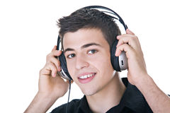 Listening to Music. Young man, enjoying music with headphones. Isolated on white Royalty Free Stock Photo
