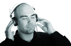 Listening to the music. Issolated portrait of a bald caucasian man listening to the music Royalty Free Stock Photos