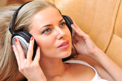 Listening to the music beautiful girl face close up Royalty Free Stock Photography