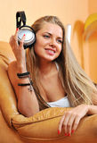 Listening to music - beautiful woman portrait relaxing at home h Stock Images