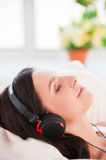 Listening to the music in bed. Royalty Free Stock Photo