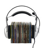 Listening to music concept, with clipping path. Headphones with stack of compact disks with clipping path Royalty Free Stock Images