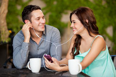 Listening to music on a date Royalty Free Stock Image