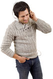 Listening to music. Happy young man with headphones, listening to music, isolated Stock Photo