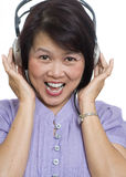 Listening to music on headphones Royalty Free Stock Photo