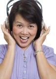 Listening to music on headphones Royalty Free Stock Photo