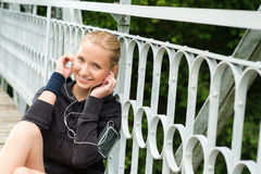 Listening to music headphones young woman resting Stock Photo