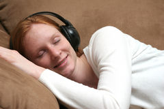 Listening to Music at Home Stock Photography