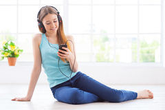 Listening to the music at home. Royalty Free Stock Photos