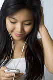 Listening to music on my earphones Stock Images