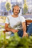 Listening to music outdoors Royalty Free Stock Photo