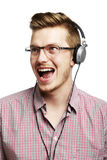 Listening to music and singing with headphones Royalty Free Stock Image