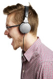 Listening to music and singing with headphones Stock Photos