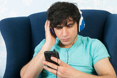 Listening to music with the smart phone Royalty Free Stock Photo