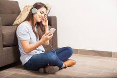 Listening to music from a smartphone Stock Photography