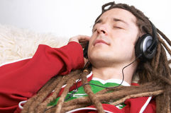 Listening to music on sofa Royalty Free Stock Photos