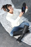 Listening to the music on the street Royalty Free Stock Image