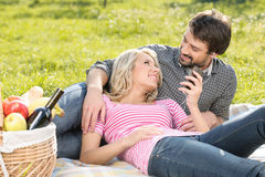 Listening to the music together. Loving young couple listening t Stock Images
