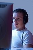 Listening to music while working. Stock Photos