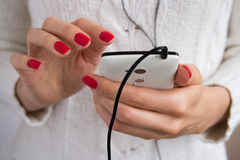 Listening to music on your phone Stock Photos
