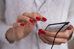 Listening to music on your phone Royalty Free Stock Images