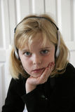 Listening to Music2. Young girl Listening to music in her bedroom Royalty Free Stock Photos