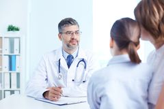 Listening to patient Stock Images