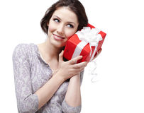 Listening to the present wrapped in red paper Stock Photography