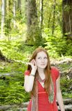 Listening to the quiet of the forest Stock Images