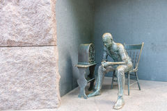 Listening to radio. Bronze statue of a person listening to radio stock photos