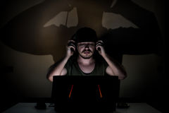 Listening to some music in the dark Stock Photo