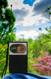Listening to a vintage transistor radio outside Stock Photography