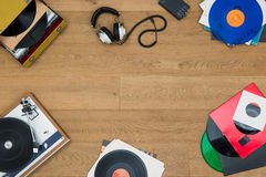 Listening to vinyl records. Top view of assorted items, associated with vinyl records, record players, music, audio, listening, in a vintage retro style, with Stock Photos
