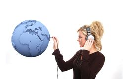 Listening to the world. A girl is listening to the world Stock Image