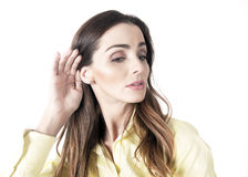 Listening woman. Woman listening cupping ear and serious expression Stock Image