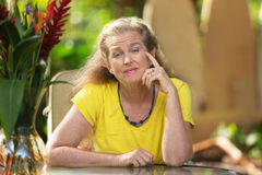 Listening Woman in Yellow Royalty Free Stock Photography