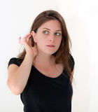 Listening young woman Royalty Free Stock Images