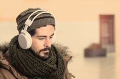 Listenng music outdoors in instagram style Royalty Free Stock Photo