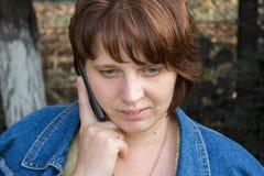 Listens carefully by phone Stock Photos
