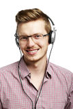 Listens and smiles with headphones Royalty Free Stock Photography