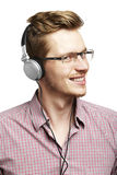 Listens and smiles with headphones Stock Photo