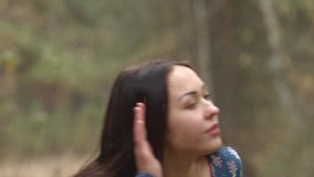 She listens to the forest. stock footage