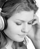 Listens to music with headphones. Beautiful young girl listens to music with headphones Stock Photo